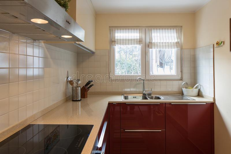 Red modern kitchen with new appliances. Nobody inside stock images