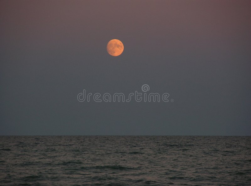 Red moon over the sea royalty free stock photography