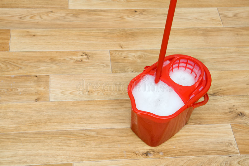 A red mop in a bucket stock images