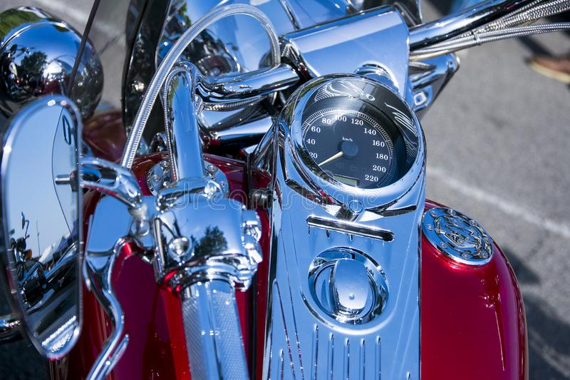 Red motorcycle with chrome finishes. A red motorcycle with chrome finishes stock photos