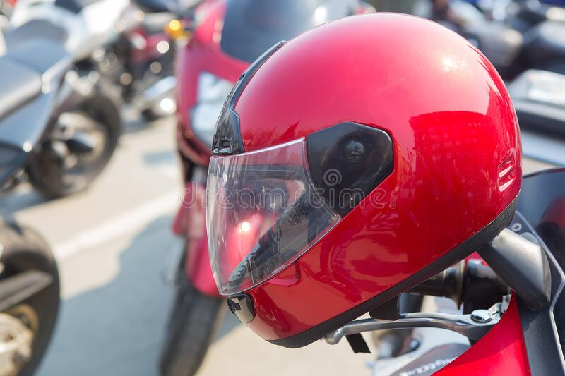 Red motorcycle helmet on a motorcycle royalty free stock photography