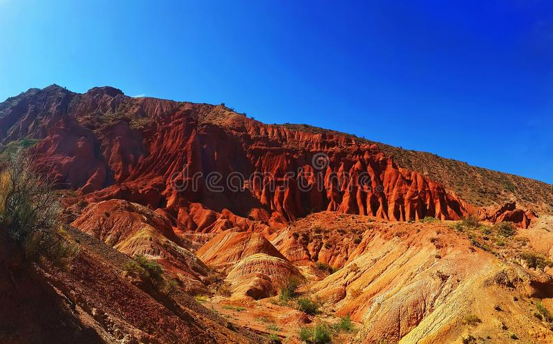 The red mountains of Issyk-Kul stock photo
