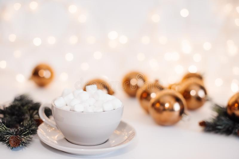 Red mugs with hot chocolate and marshmallows and gingerbread cookies. Christmas concept stock photography