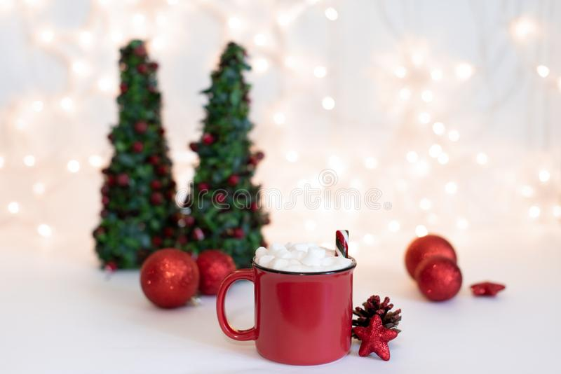 Red mugs with hot chocolate and marshmallows and gingerbread cookies. Christmas concept stock photo