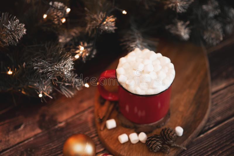 Red mugs with hot chocolate and marshmallows and gingerbread cookies. Christmas concept stock image