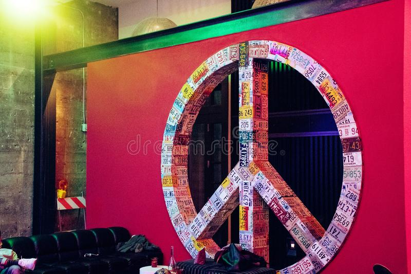 Red and Multicolored License Plate Covered Peace Sign Wall Decor royalty free stock photos
