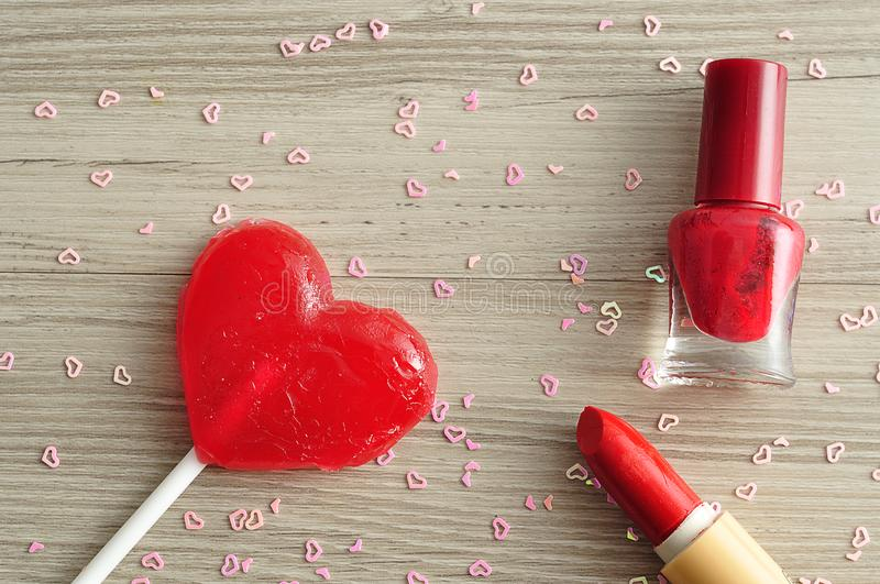 Red Nail Polish And Lipstick Displayed With A Red Heart Shape ...