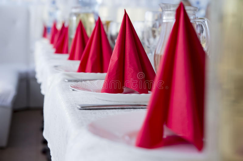 Red napkins for table layout royalty free stock image