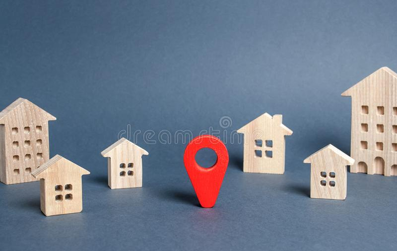 Red navigation pointer in a city or town. Places and sights in the city. Location and routes. The concept of travel and choosing. A new place of residence stock photos
