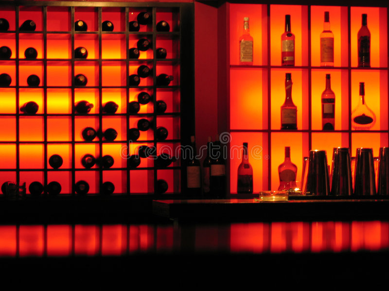 Red nightclub bar glowing bottles background stock image