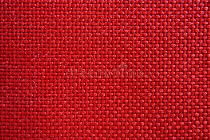 Red nylon fabric pattern texture. Red nylon fabric pattern texture background royalty free stock images