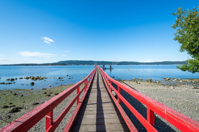 Red ocean pier stock photography