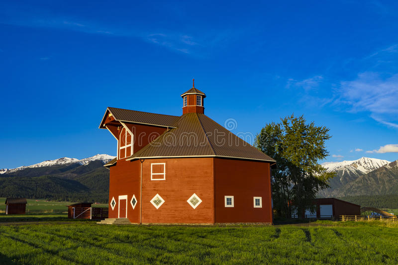 Red octagonal barn. Near the Wallowa Mountains in Oregon royalty free stock photography