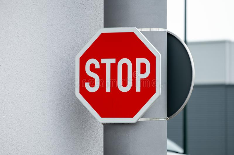 Red Octagonal Stop Sign. Stop sign, red octagonal, mounted on a grey pillar royalty free stock images