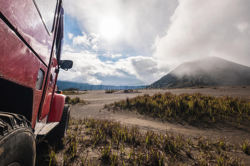 Red off road car at Mount Bromo, Indonesia, adventure trial royalty free stock photography