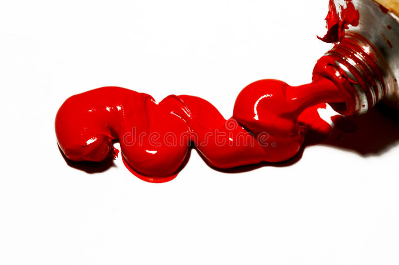 Red oil paint. Macro of red oil paint isolated royalty free stock photos