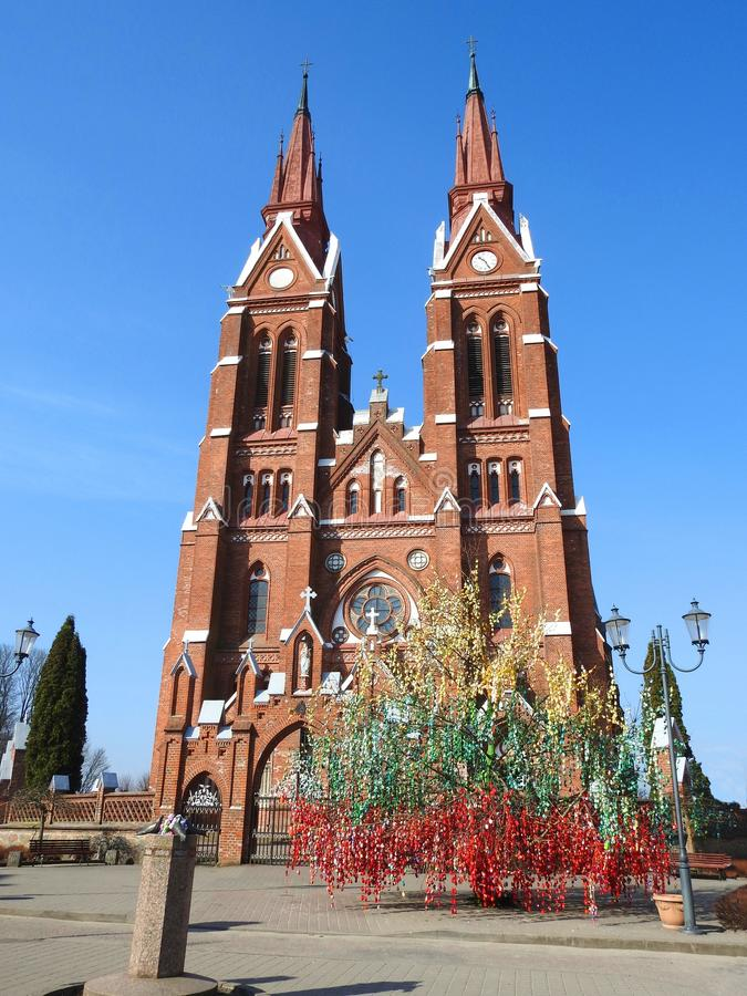 Church and Easter eggs tree in Sveksna town, Lithuania royalty free stock image