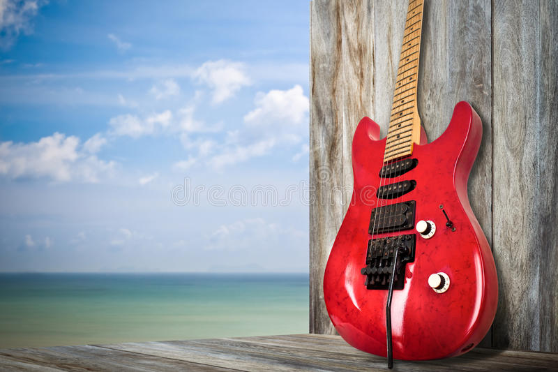 Red Old Electric Guitar. A red old electric guitar on a dock by the bay royalty free stock image