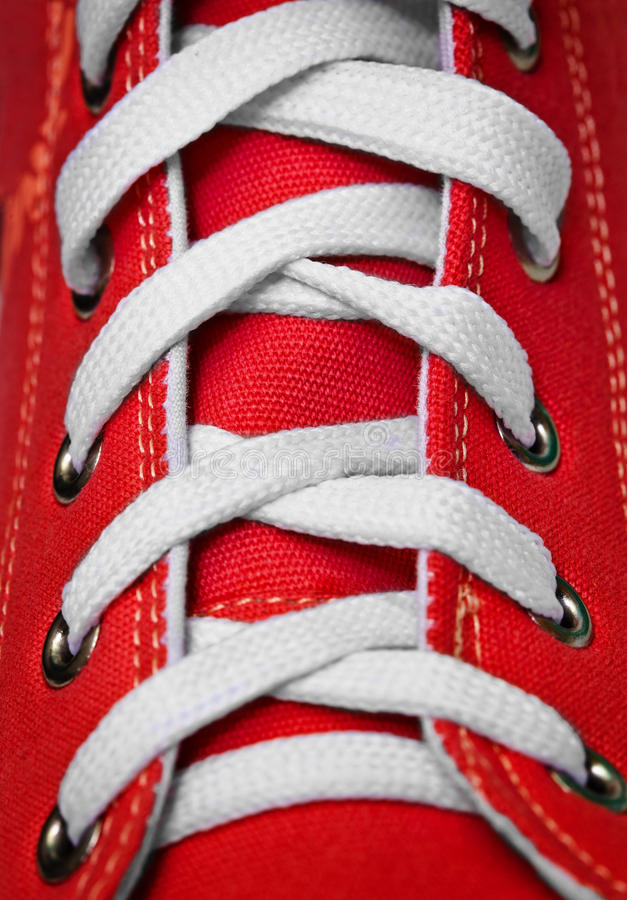 Red old-fashioned gym shoe - lacing. On red old-fashioned gym shoes a lacing close up royalty free stock photos