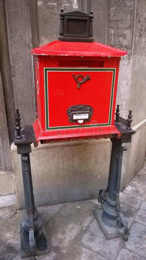Traditional old red postbox. Retro style stock photos
