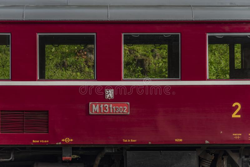 Red old historical diesel train with cargo green car in Ceska Kamenice town stock photo