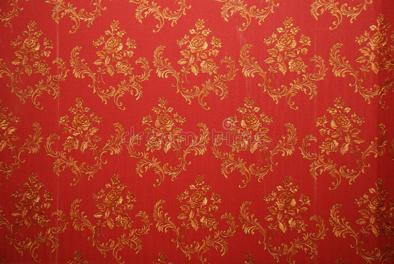 Red old wallpaper. Old red wallpaper texture with flowers on them royalty free stock image