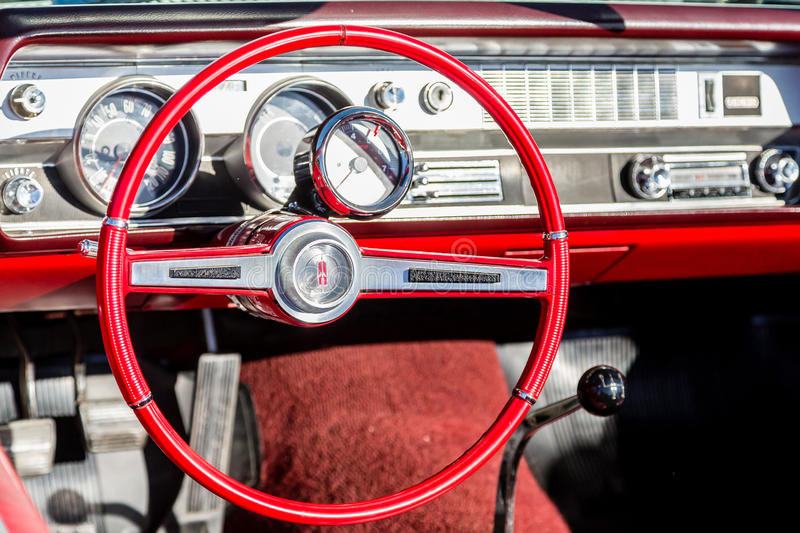 Red Oldsmobile Interior. ATLANTA, GEORGIA - July 3, 2016: Caffeine and Octane is a nationally recognized car show held monthly, displaying hundreds of classic royalty free stock photography