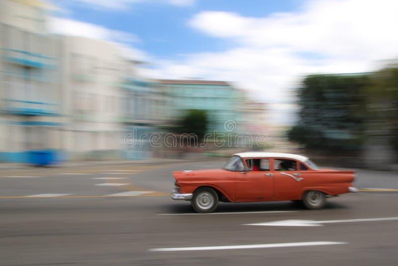 Red oldtimer car running in Havana street, Cuba. Shiny Red oldtimer car running in Havana street, Cuba stock image