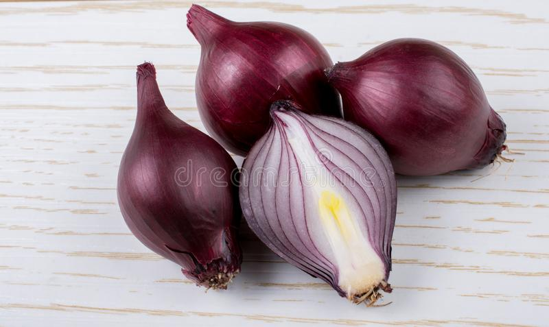 Red onion bulb cut in half on certain  background royalty free stock photos