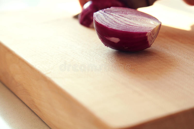 Red Onion on chopping board stock photos