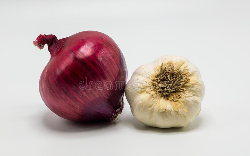 A red onion and a garlic bulb isolated on white royalty free stock photo