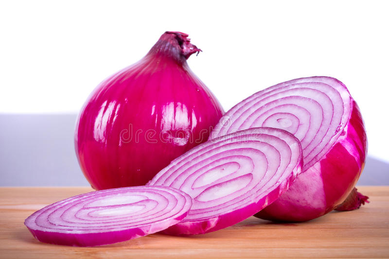 Download Red Onion Sliced On Cutting Board Royalty Free Stock Photo - Image: 26531305