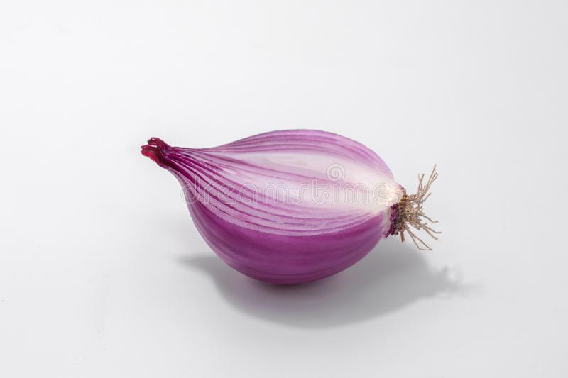 Red onion , sliced , half a piece royalty free stock photos
