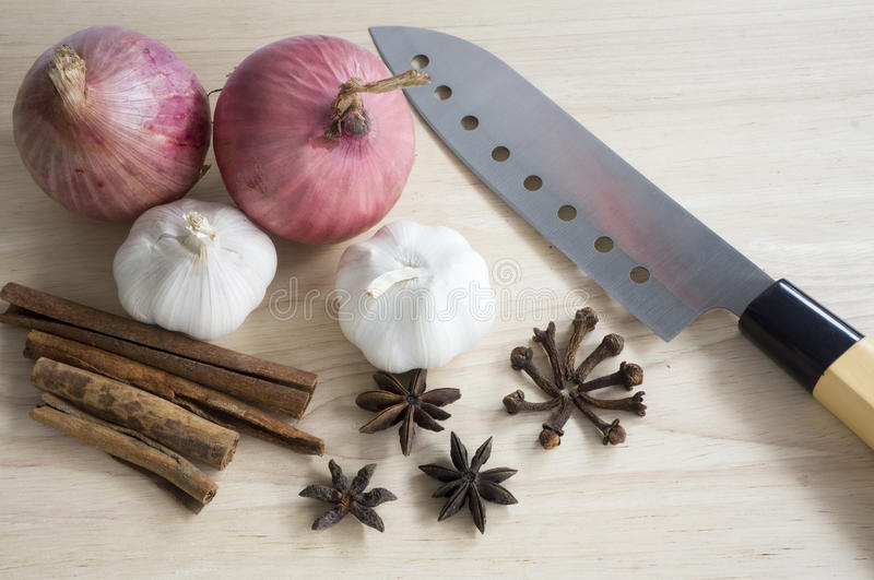 Red Onions and Garlic. Closeup view of spice ingredients with knife royalty free stock photo