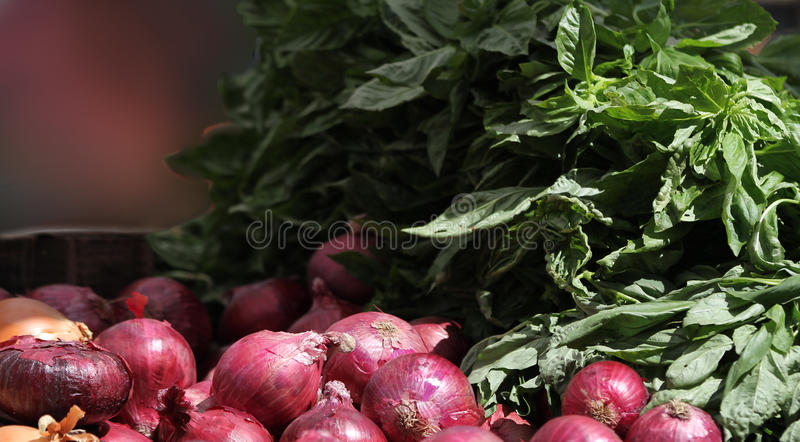 Red onions for sale at a local farmers market. royalty free stock photography