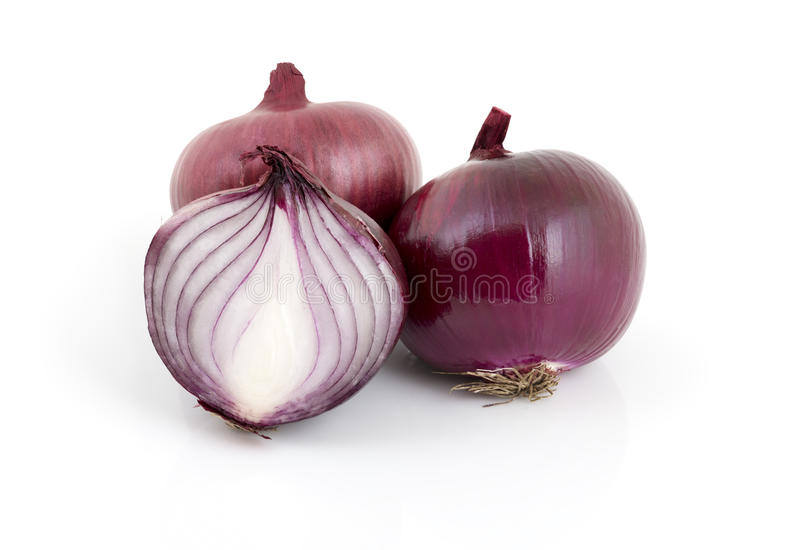 Red onions. Whole and cut red onions isolated on white royalty free stock photos