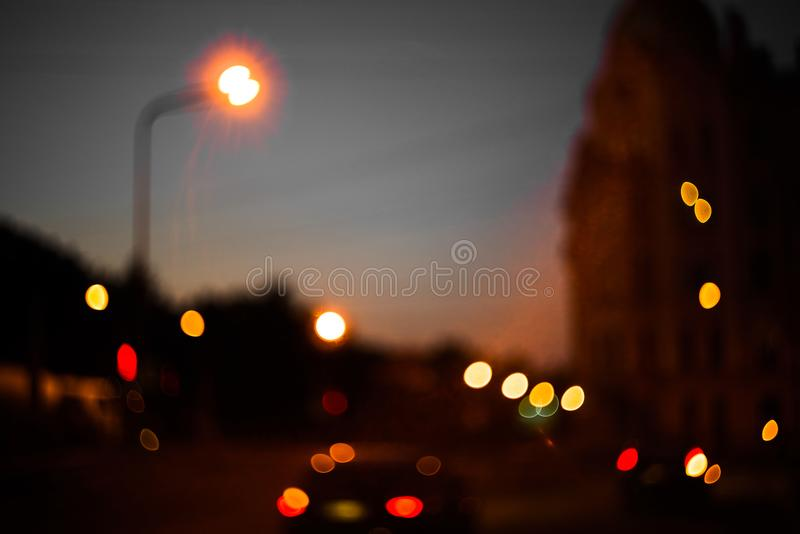 Abstract red and orange blurry background with cars and street pillars at night. Red and orange blurry background with cars and street pillars at night royalty free stock photos