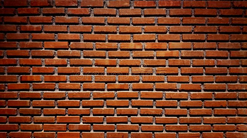 RED orange brick wall concrete background  old vintage  horizontal architecture dark wallpaper texture construction building for royalty free stock images