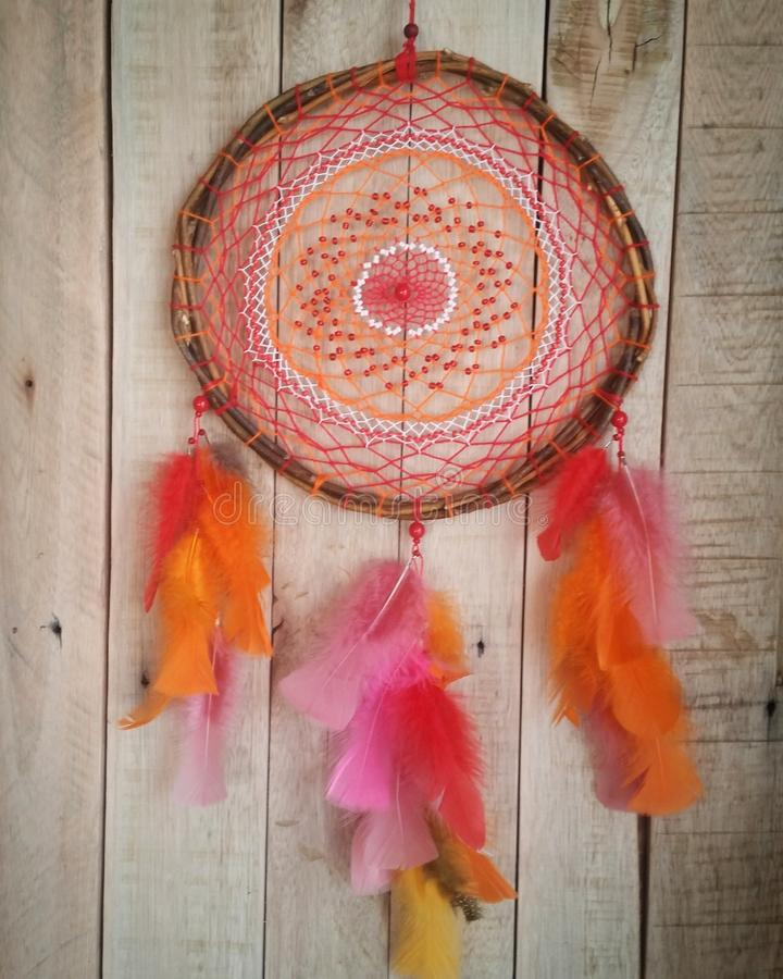 Red and orange dreamcatcher willow hoop royalty free stock images