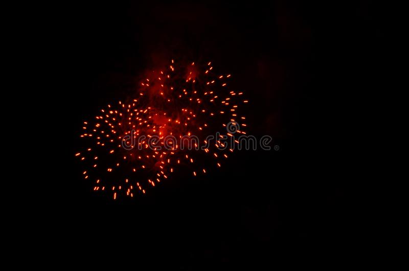 Foreworks exploding on a black night sky stock image