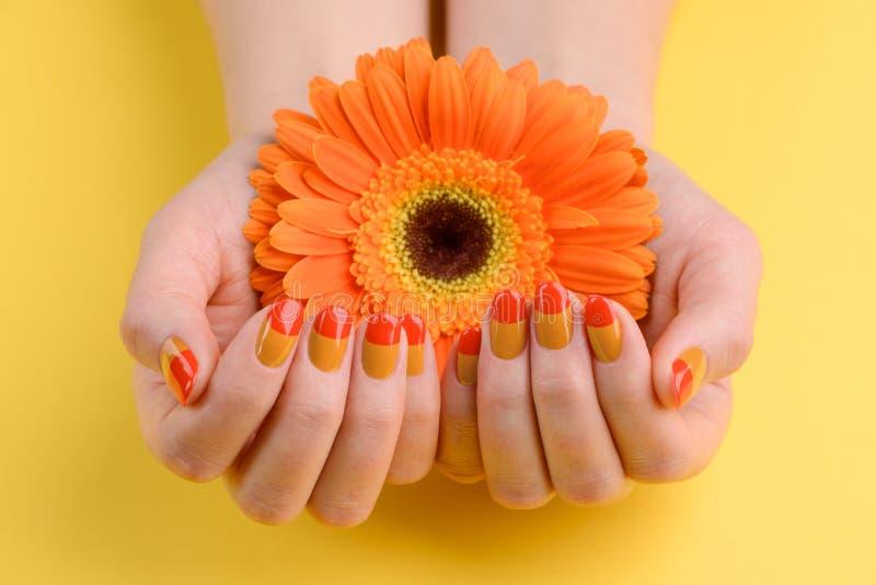 Red and orange nail art royalty free stock photo