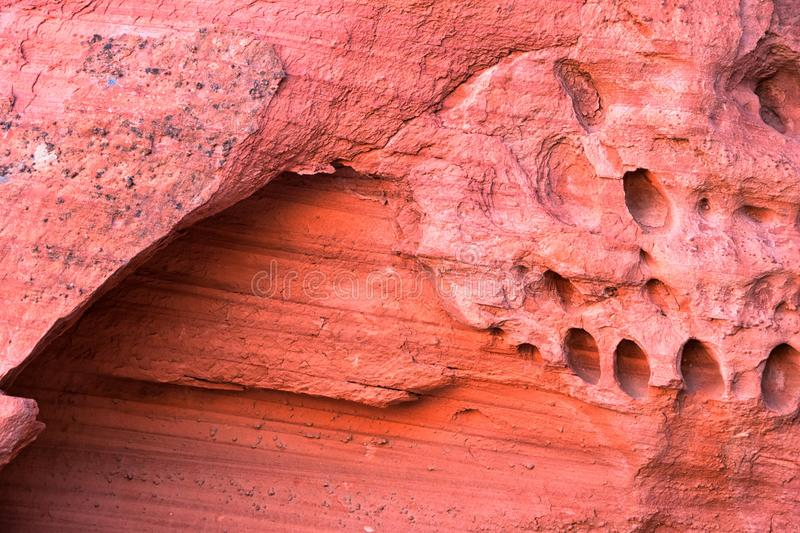 Red and Orange Sandstone Rock Formations along the Bone Wash Elephant Arch Trail in Red Cliffs National Desert Reserve in Saint Ge. Orge, Utah. United States royalty free stock image