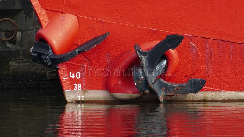 Red-orange ship with ship anchor stock photography
