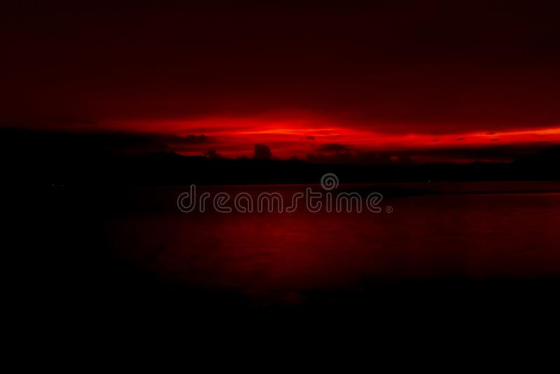 Red and orange sunset sky at the mountain and lake. Beautiful evening sky. Majestic sunset sky. Nature background. Art picture royalty free stock photo