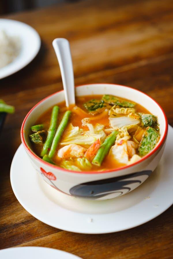 Red orange Thai local traditional hot sour spicy curry soup. Red orange Thai local traditional hot sour spicy curry soup stock images