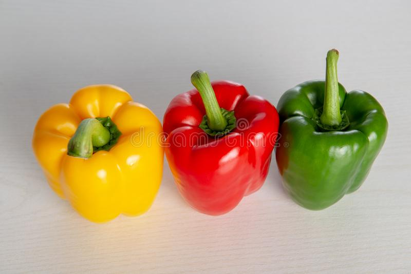 Red,orange and yellow filled pepper. On bright ground royalty free stock photography