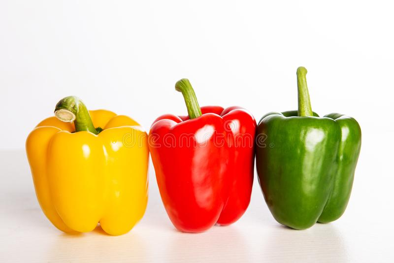 Red,orange and yellow filled pepper. On bright ground stock images
