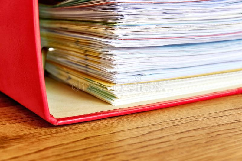 Red ordner or document binder with paperwork stock photo
