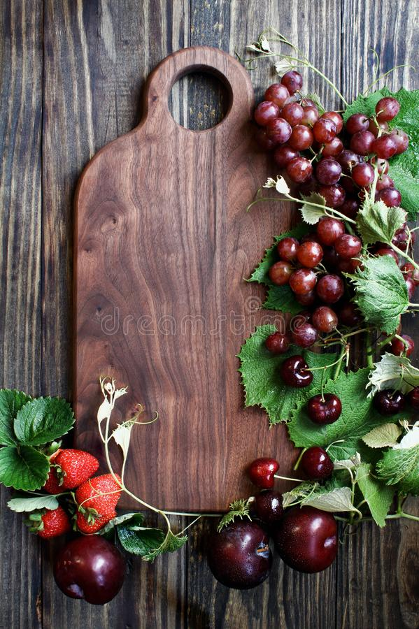 Red Organic Homegrown Fruit and Cutting Board stock photo