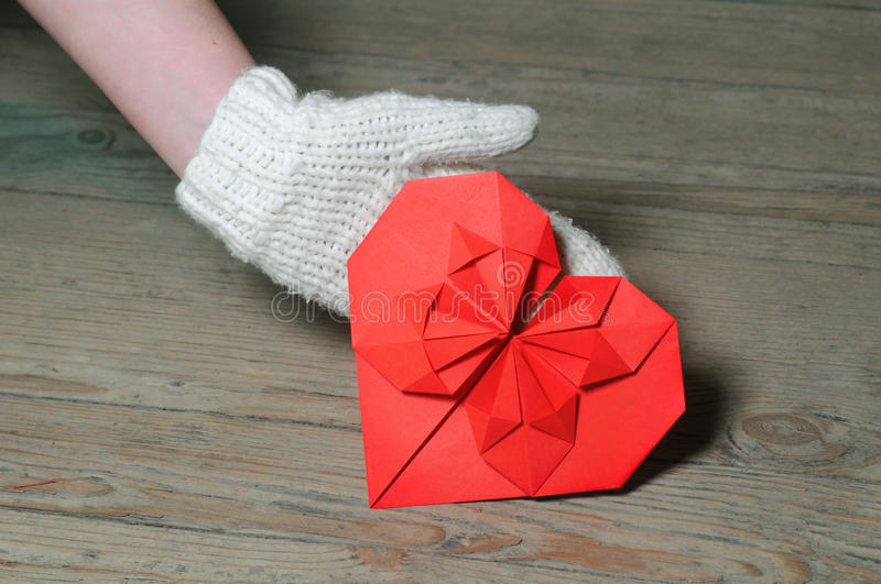 Red origami heart on wooden background stock photo